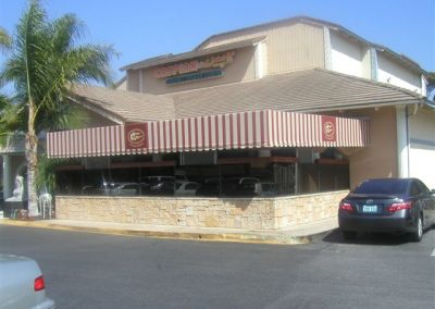 Brown and White Striped Patio Awning